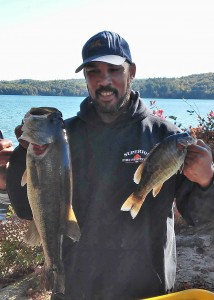 Jeff Moore showing his 8.20 lb largemouth he caught on Suncook 2014